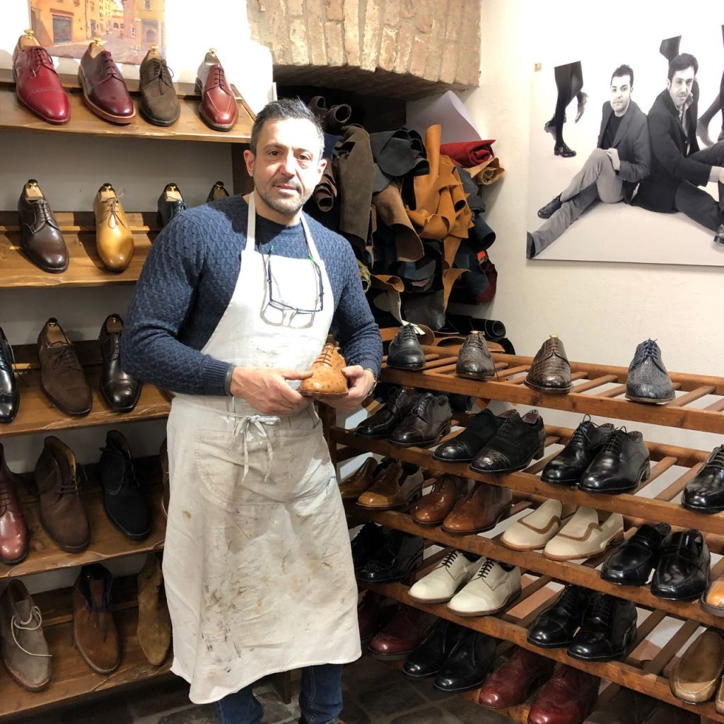 Shoemaker Max in his Bologna store. Photo credit: Juhn Maing