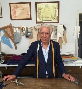 Sicilian tailor Arrigo at his cutting table. Photo credit: Juhn Maing