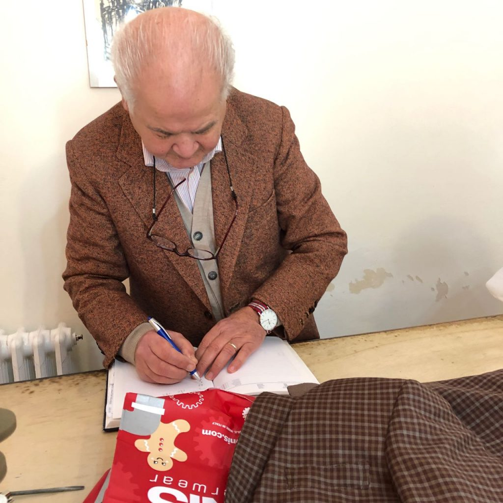 Sicilian tailor Laterra writing down my measurements in his notebook. Photo credit: Juhn Maing.